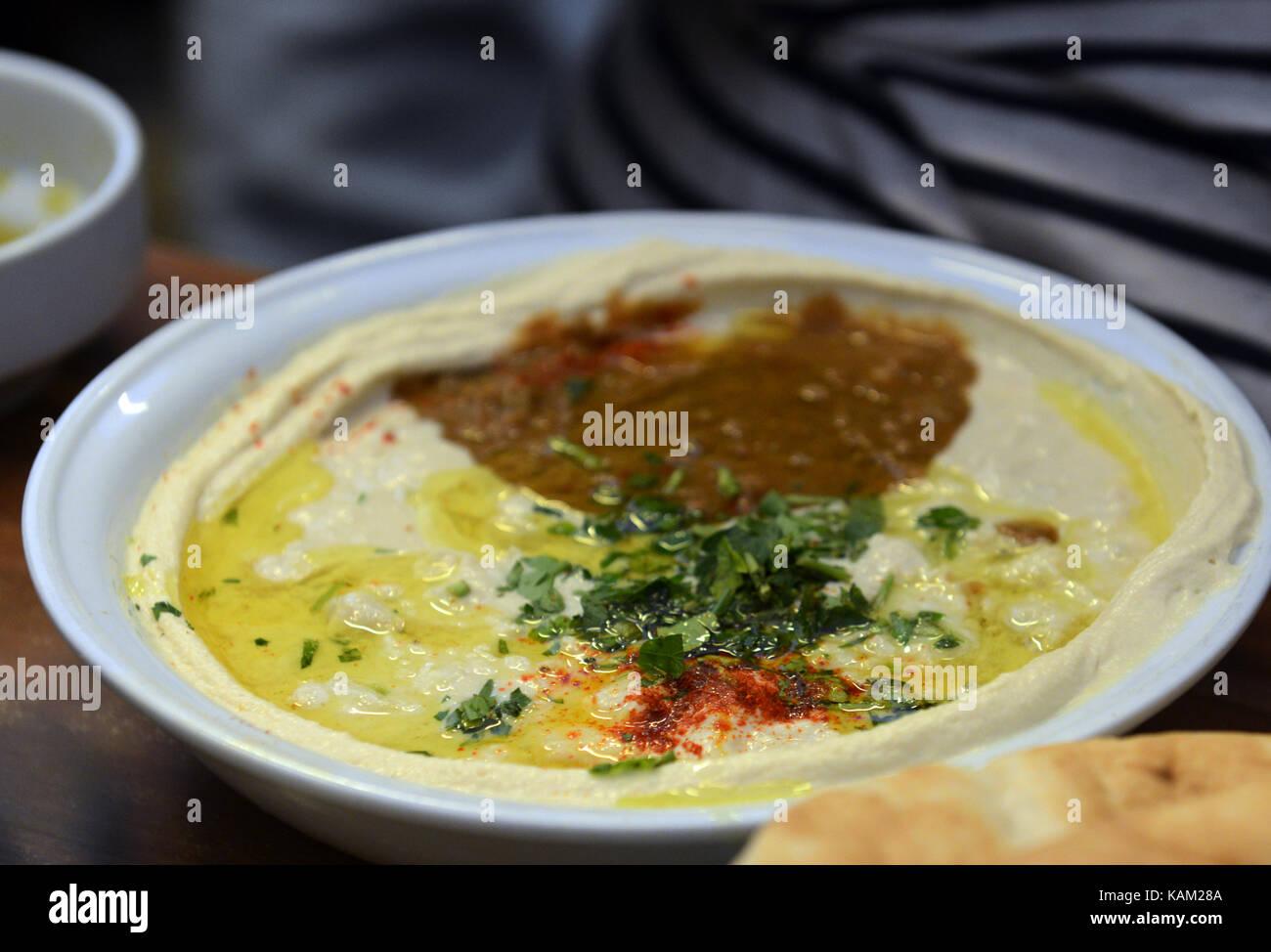 A plate of Hummus, Fuul and Masabacha at Abu Hasan / Ali Karavan restaurant in Jaffa. - Stock Image