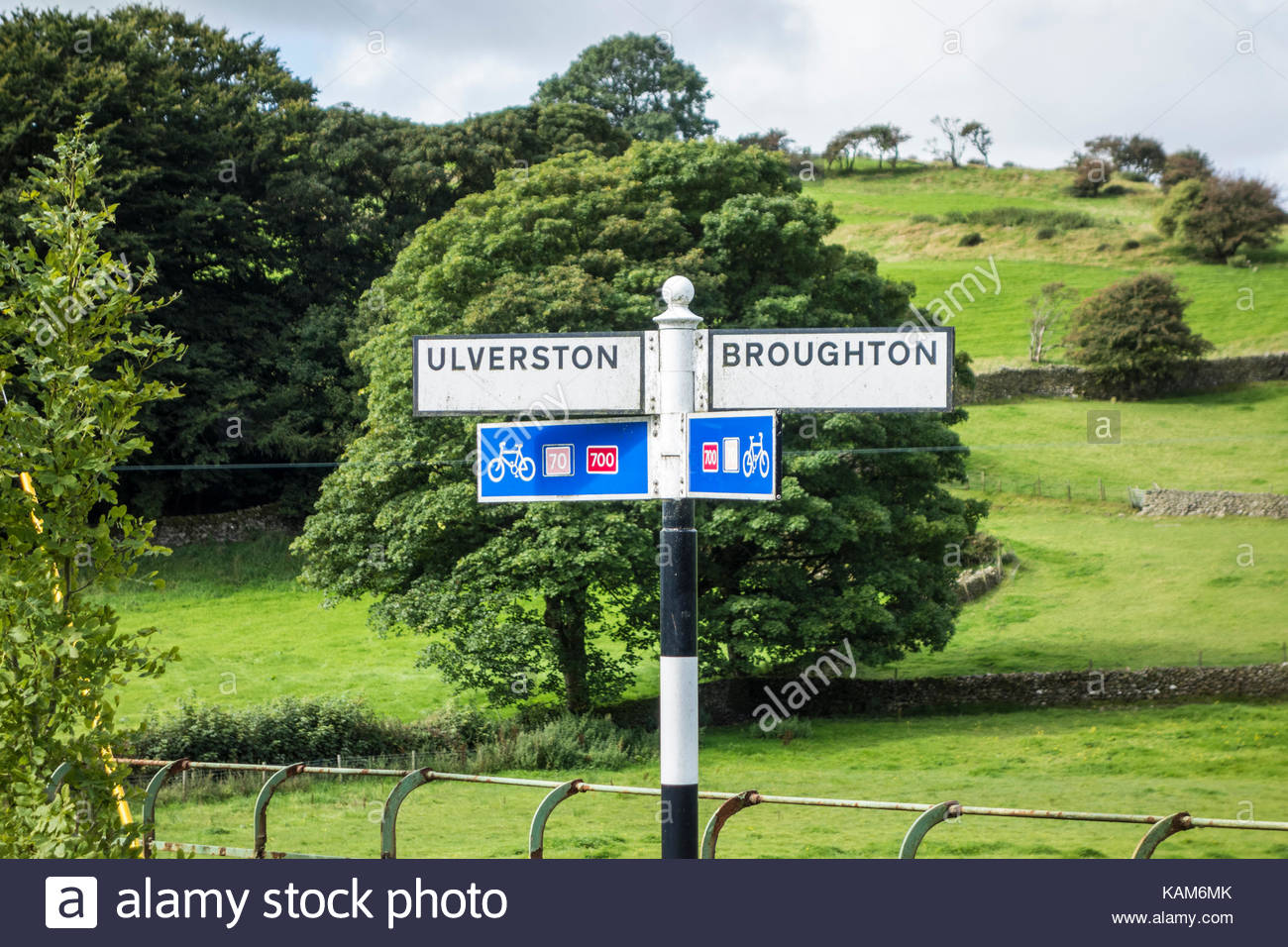 Sign post for Ulverston and Broughton on the Bay Cycleway and National Cycle Network routes 70 and 700 - Stock Image