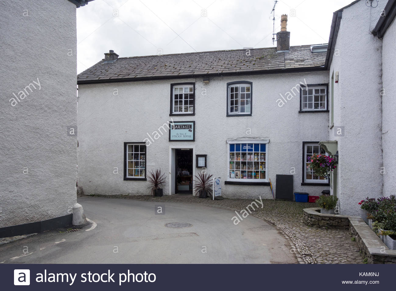 Cartmel village in Cumbria on the route of the Bay Cycleway and home of the sticky toffee pudding - Stock Image