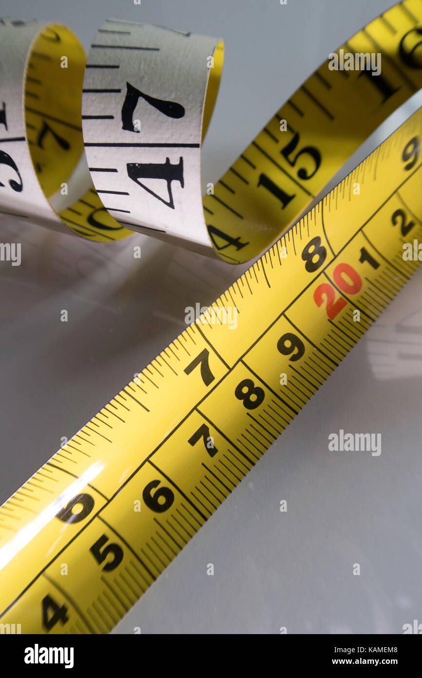Cloth and Metal Tape Measures - Stock Image