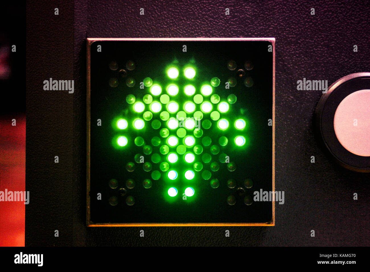 green led illuminated arrow sign - Stock Image