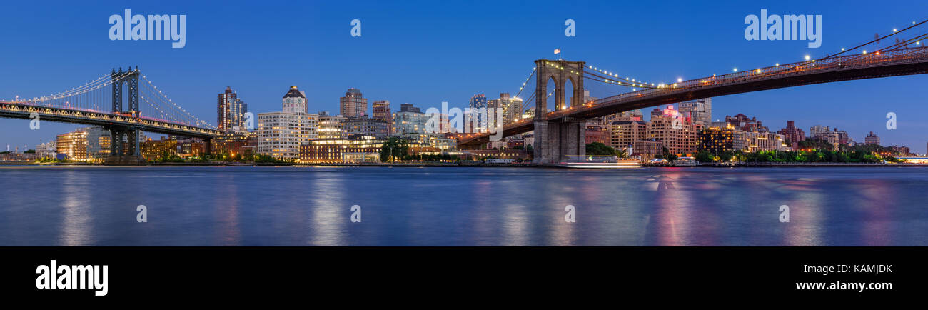 Evening panoramic view of Brooklyn Riverfront between the Manhattan Bridge and Brooklyn Bridge. Dumbo, Brooklyn, - Stock Image