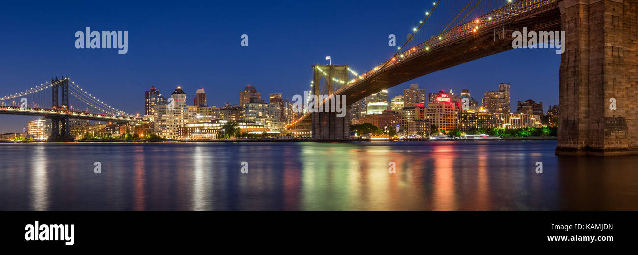 Evening panoramic view of Brooklyn Riverfront between the Manhattan Bridge and the Brooklyn Bridge. Dumbo, Brooklyn, - Stock Image