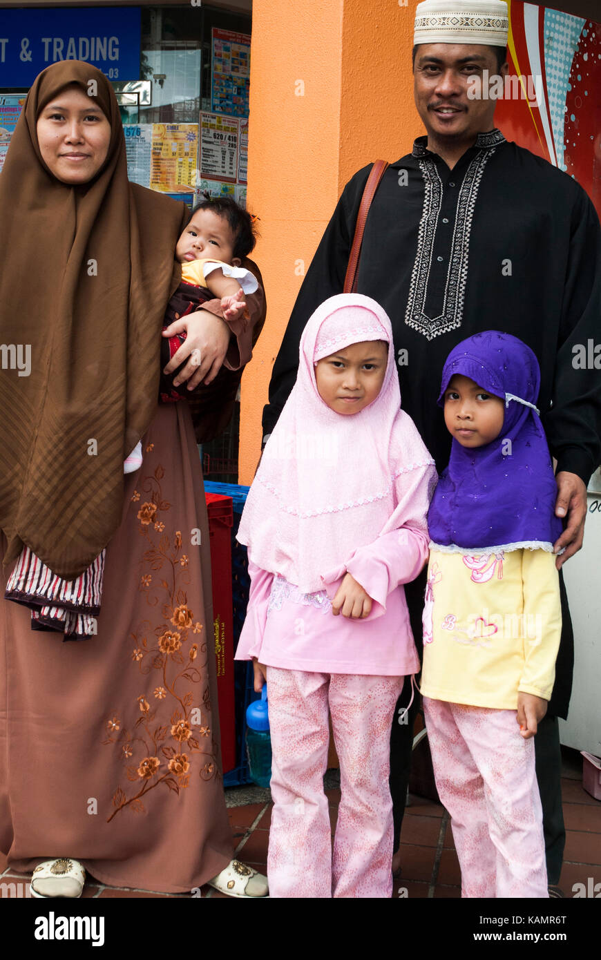 Malay family outside the Geylang Serai market, Singapore - Stock Image