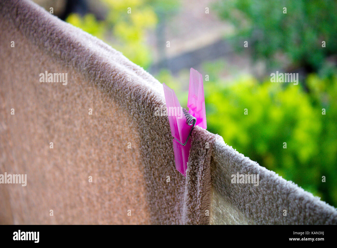 housework wash and hung of the clothes eith clothespin - Stock Image