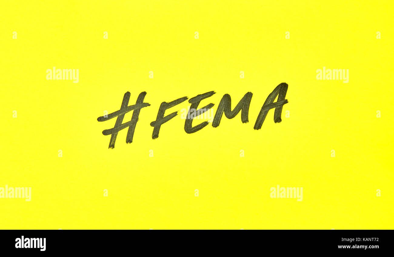 Popular hashtag fema written on a yellow paper - Stock Image