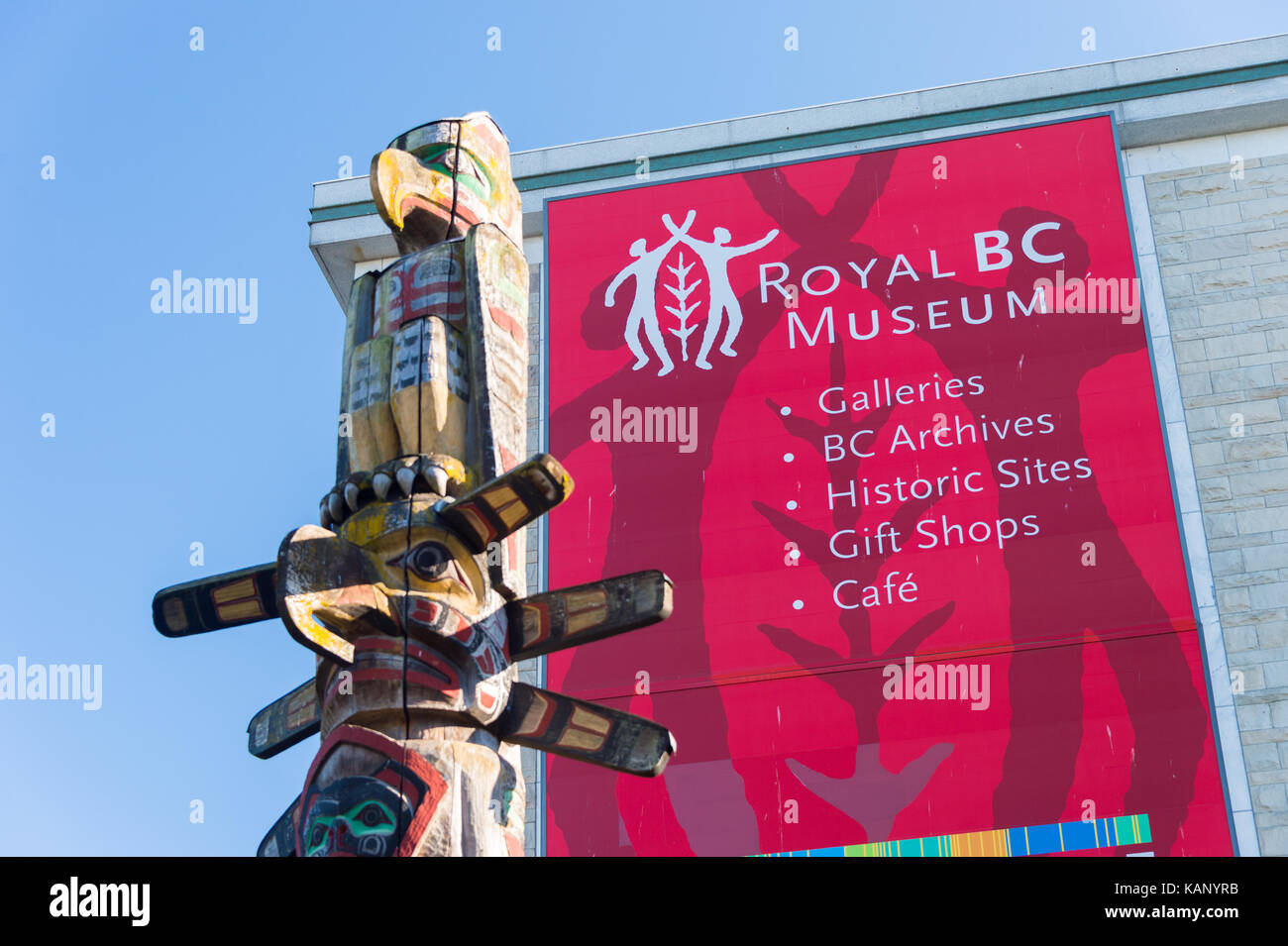 Victoria, BC, Canada - 11 September 2017: Facade of the Royal BC Museum with a totem pole in the foreground - Stock Image