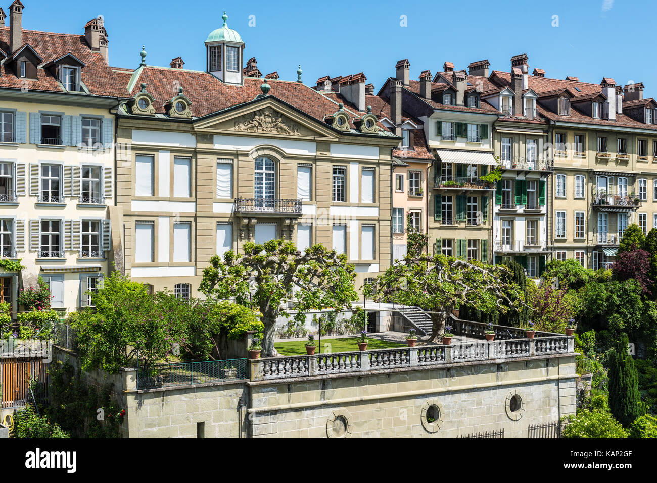 Bern, Switzerland - May 26, 2016: Upscale residential area with gardens near the Bern Cathedral and Aare River. Stock Photo