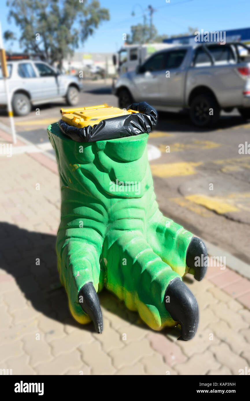 Rubbish bin in the shape of a dinosaur foot in the small rural town of Winton, Queensland, QLD, Australia - Stock Image
