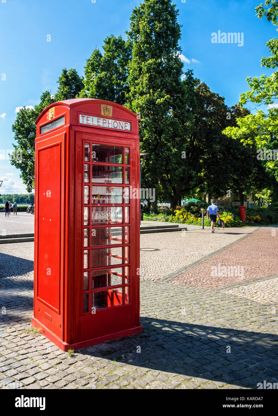 Berlin,Alt-Tegal,Old Tegal. English red telephone box on the Greenwich Promenade next to Tegel Lake -twinned with - Stock Image