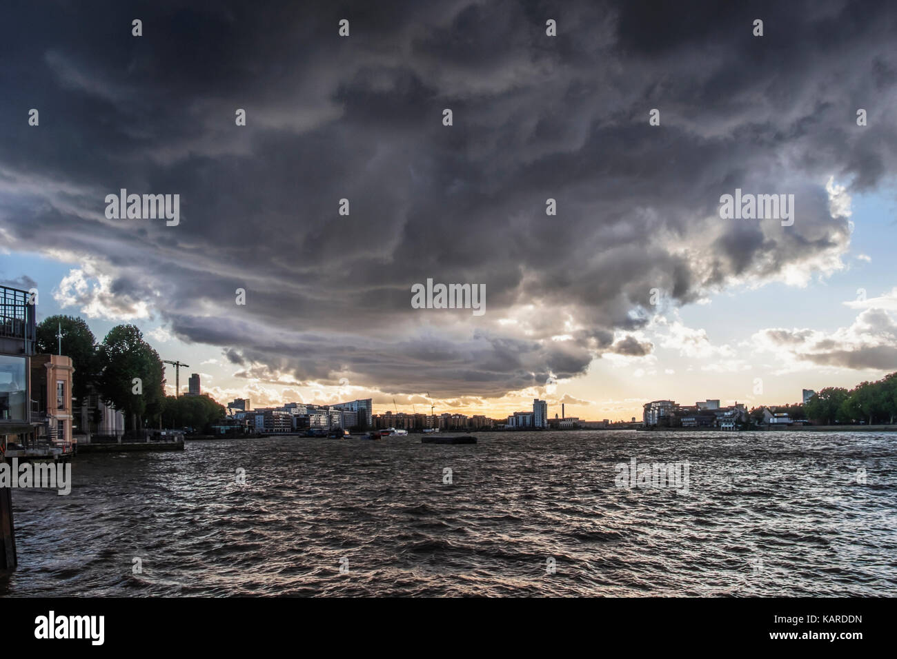 Greenwich, London. Thames river view with choppy water,stormy black sky, black storm clouds.approaching sorm,bad - Stock Image