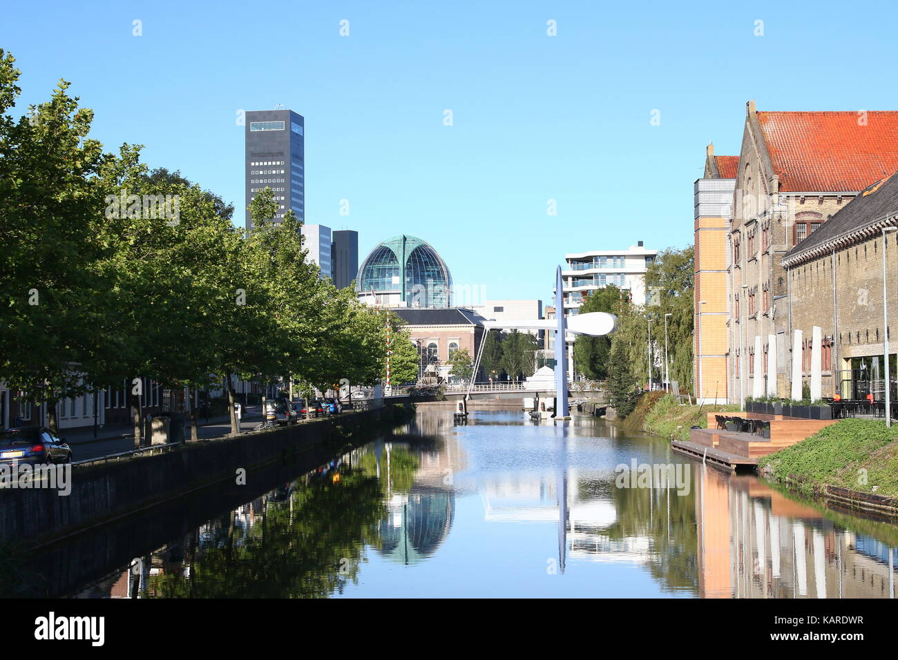 Skyline of Leeuwarden,  The Netherlands with Achmeatoren skyscraper and on right  Blokhuispoort, former prison complex. - Stock Image