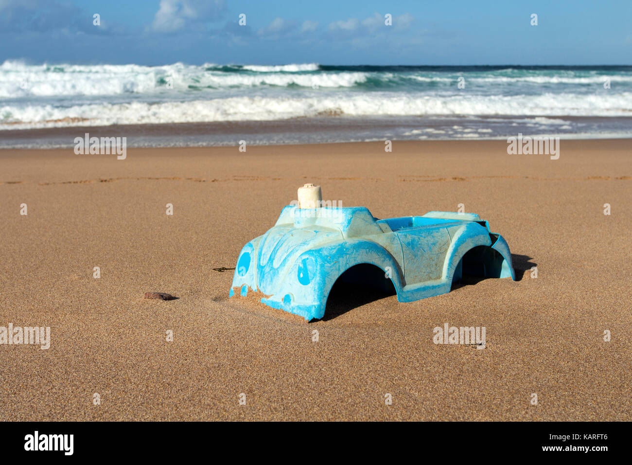 Plastic Toy Car Washed up on a Remote Scottish Beach UK - Stock Image