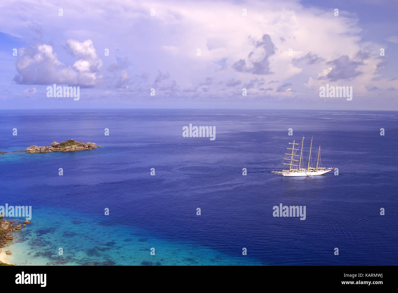 Similan of Iceland in the Andaman Sea and the Ship star flyer in background, Similan Islands in the Andaman Sea - Stock Image
