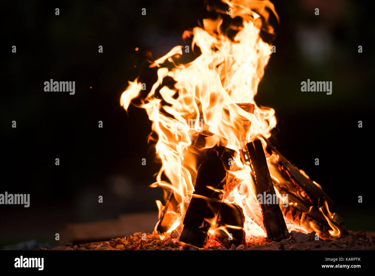 Fireplace outside in the dark. - Stock Image