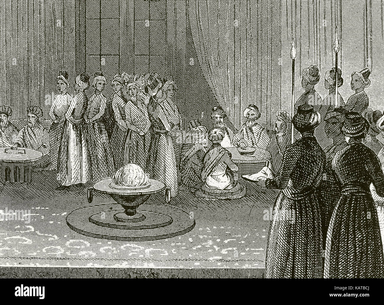 Ottoman Empire. Banquet held at the court of Topkapi Palace. Engraving. 19th century. - Stock Image