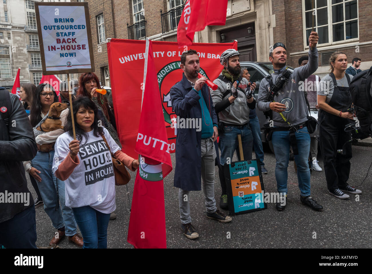 London, UK. 27th Sep, 2017. A security man tells Independent Workers Union of Great Britain President Henry Chango - Stock Image