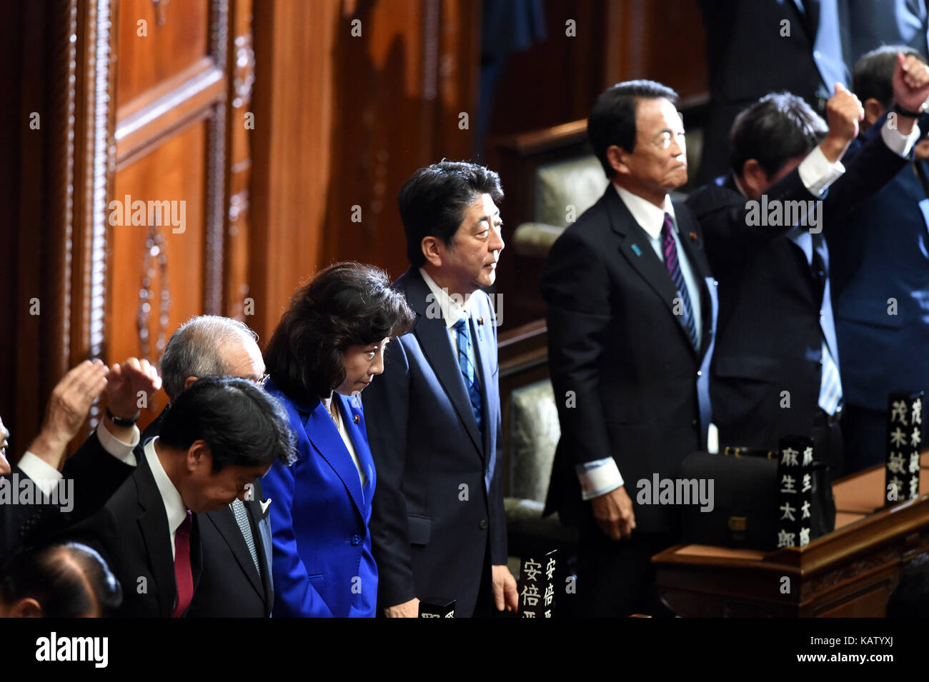 (170928) -- TOKYO, Sept. 28, 2017 (Xinhua) -- Japanese Prime Minister Shinzo Abe (C) listens as House of Representatives Stock Photo