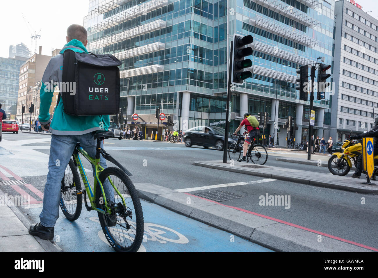 An Uber Eats delivery cyclist outside Uber Headquarters in Aldgate
