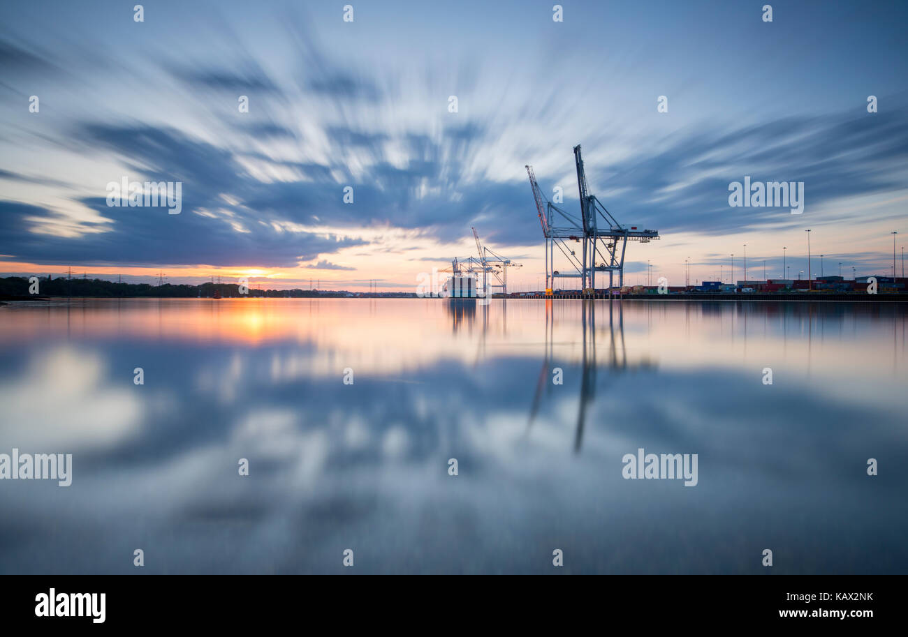 Southampton Docks viewed from Marchwood at sunset. - Stock Image
