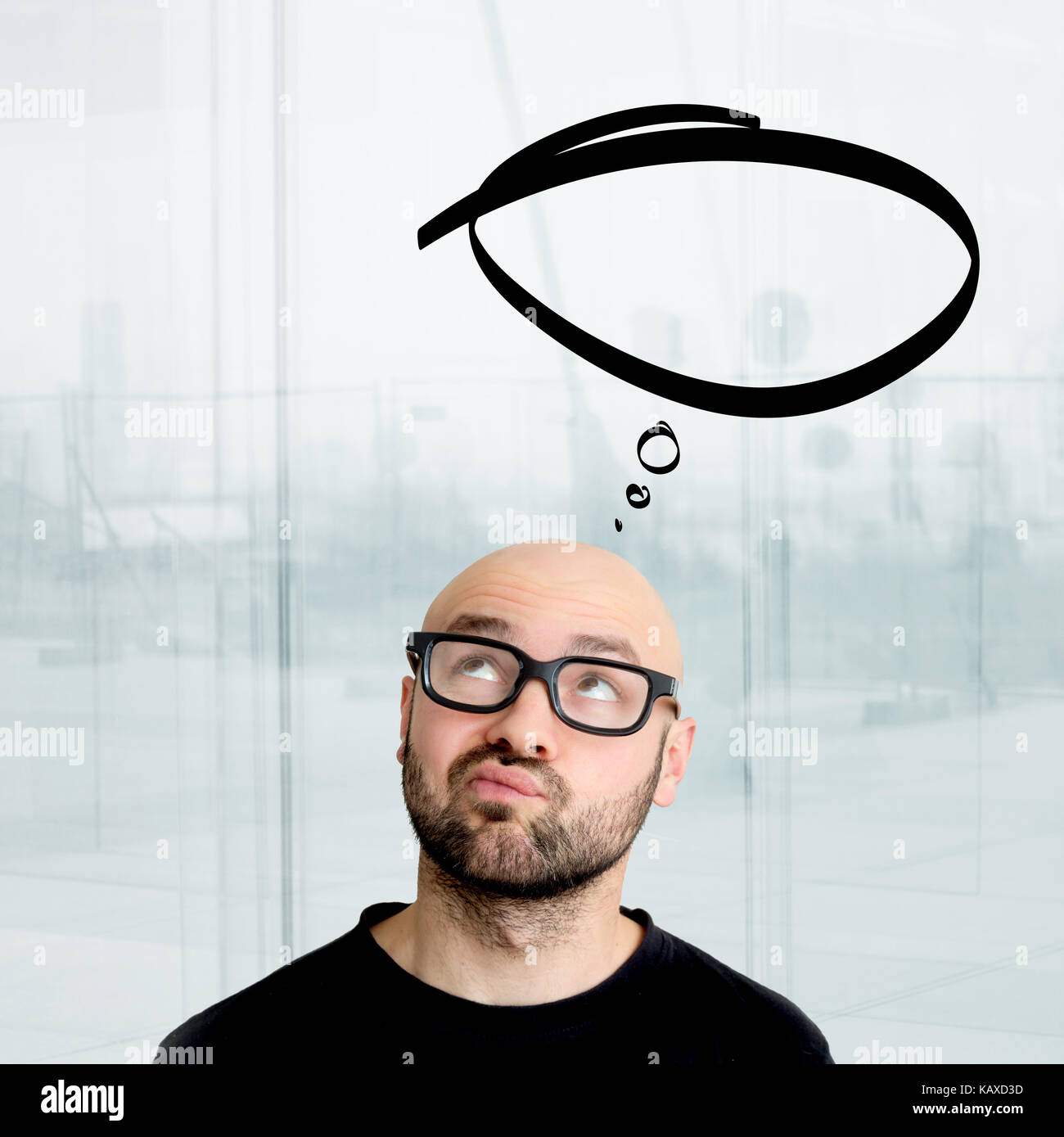 Portrait view of an attractive dubious geek man with thinking comics bubble over his head - Stock Image