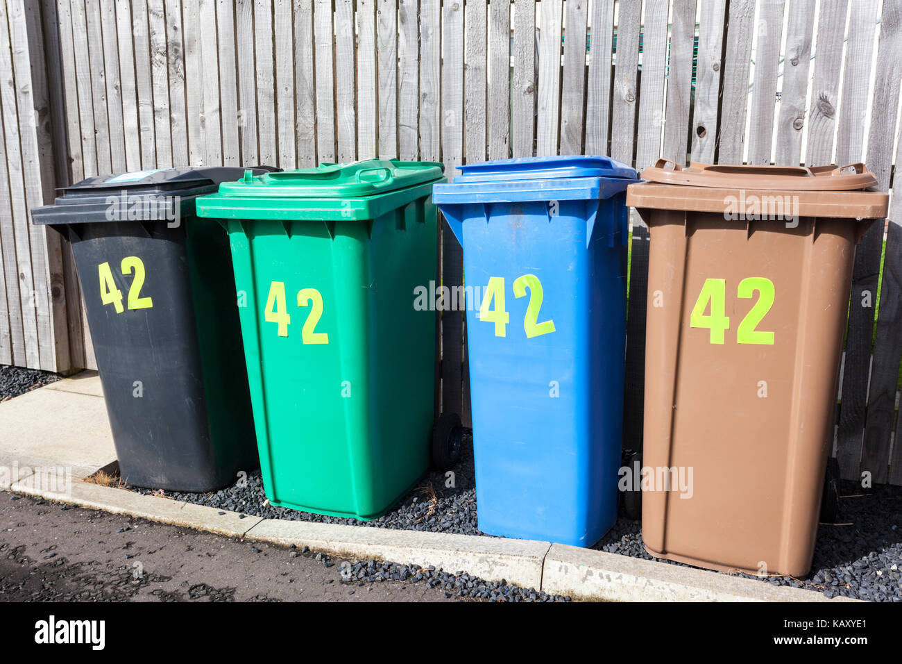 Four full sized recycling wheelie bins for one property at Anstruther, Fife, Scotland UK Stock Photo