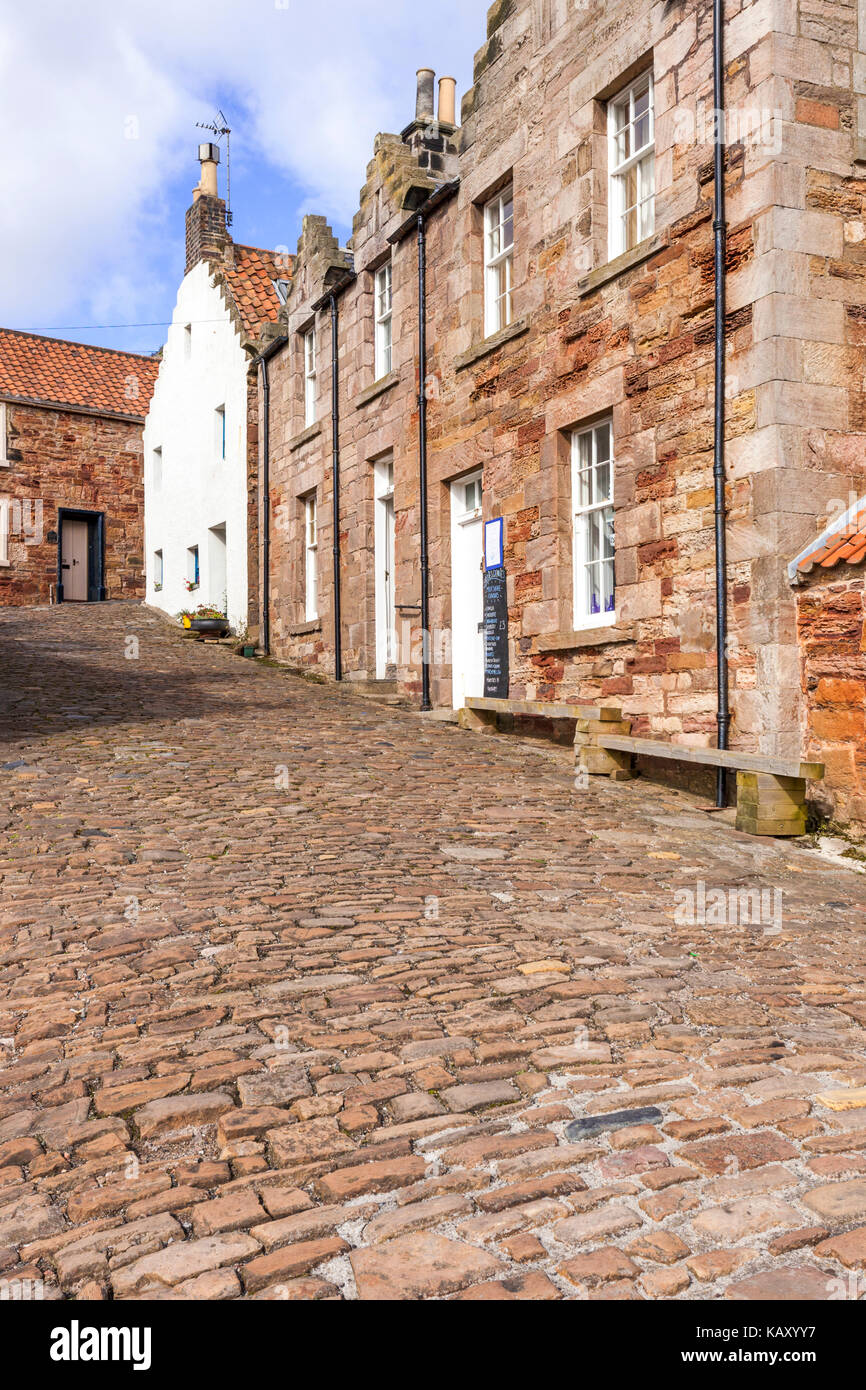 A cobbled lane in the fishing village of Crail, Fife, Scotland UK - Stock Image
