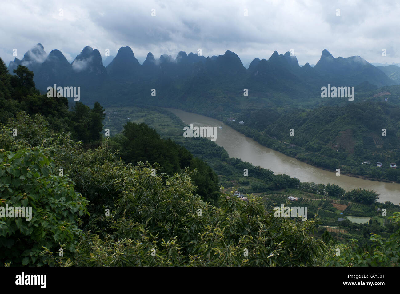 Beautiful Chinese natural landscape with karst hills, green mountains, small village, countryside near Xinping, Stock Photo
