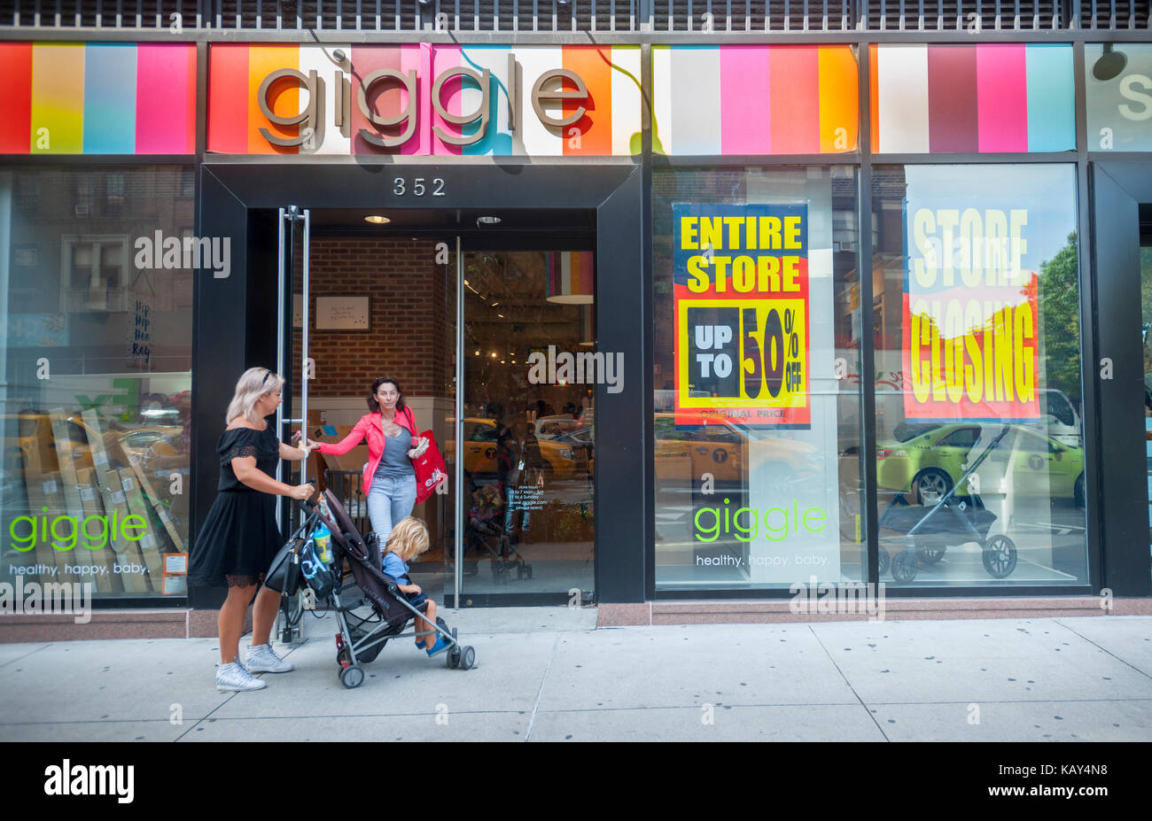A Giggle baby boutique in the Upper West Side neighborhood in New York on Tuesday, September 26, 2017 announces - Stock Image
