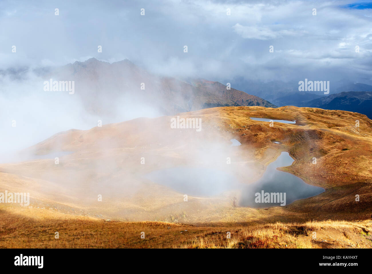 Majestic mountain landscape. Koruldi lakes and a tourist admiring the view. Active life concept - Stock Image