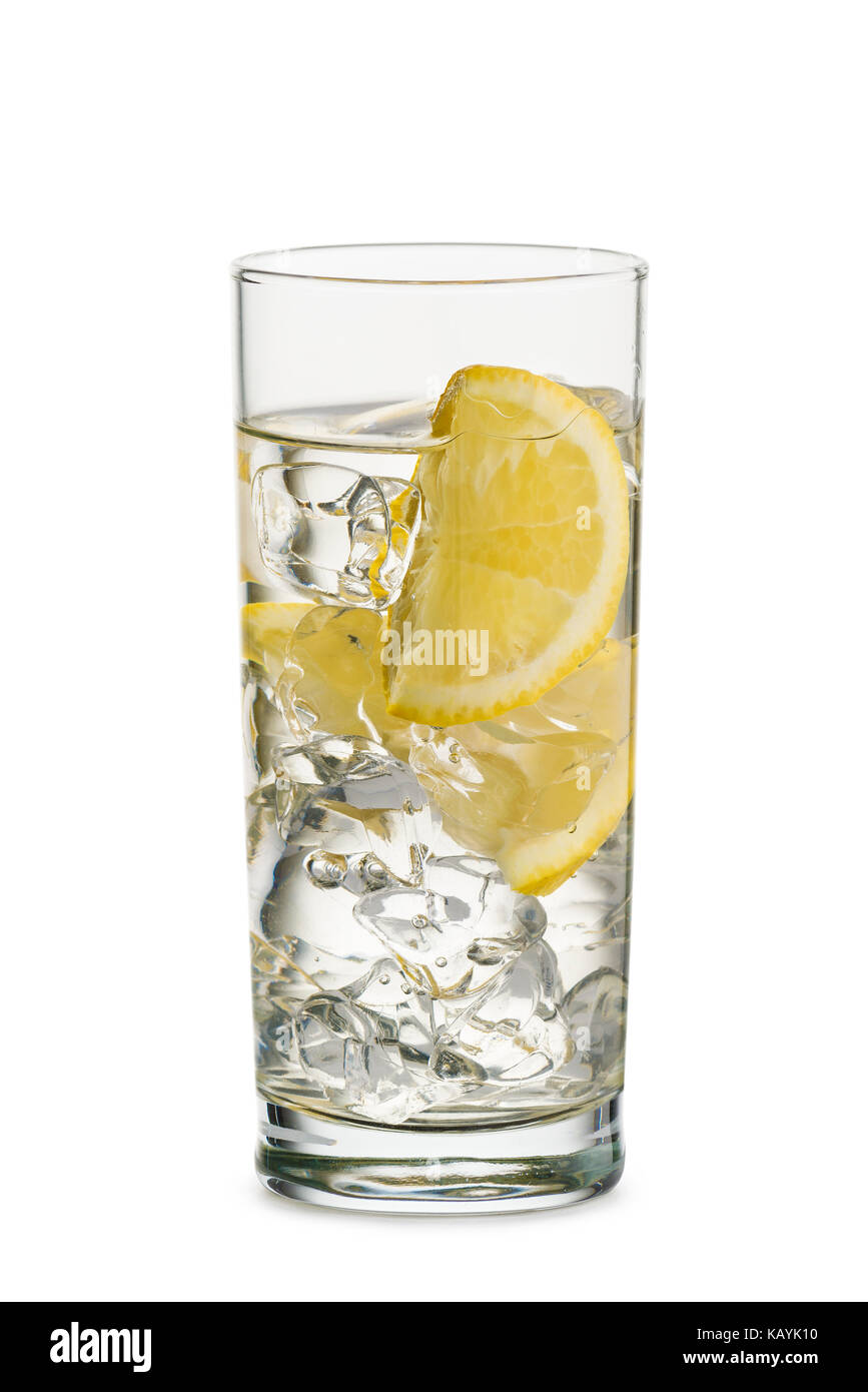 glass full of fresh water with lemon slices, on white background - Stock Image