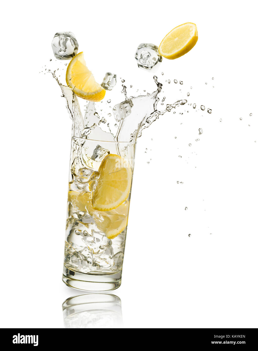 glass full of water with lemon slices and ice cubes falling and splashing water, on white background - Stock Image