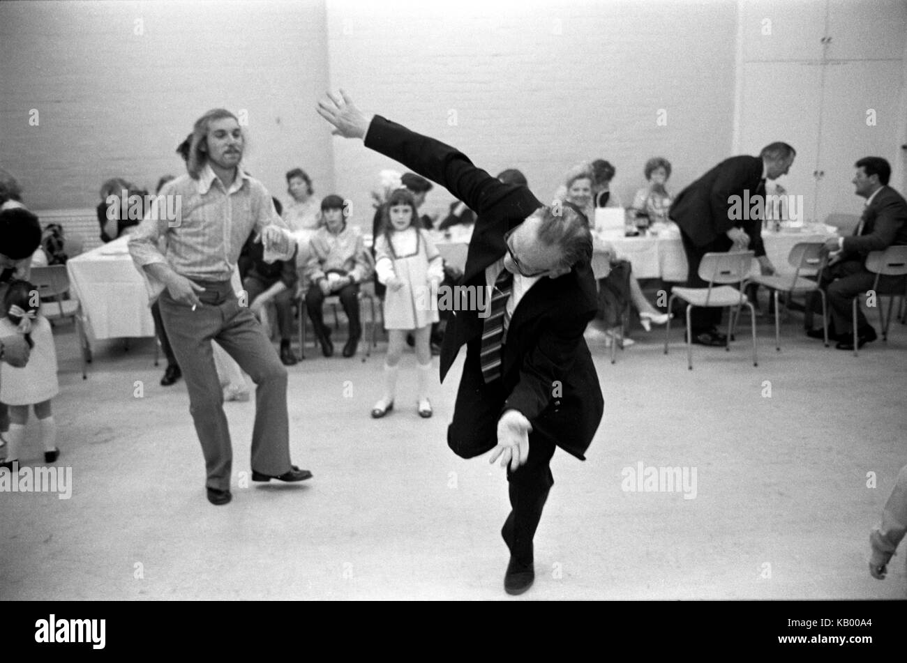 Dad dancing at wedding party reception senior older elderly man making a fool of himself. 1970s UK HOMER SYKES - Stock Image