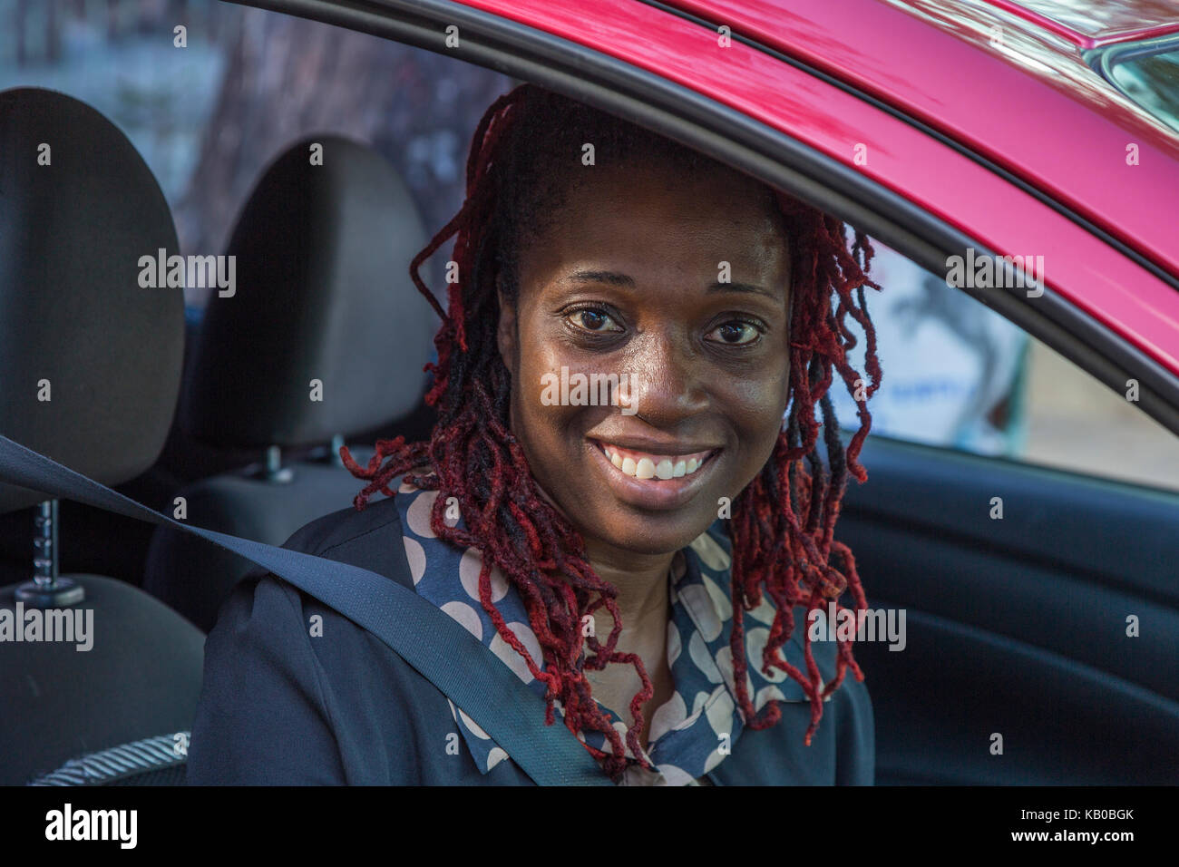 St. Johns, Antigua.  Young Woman in her Car. - Stock Image