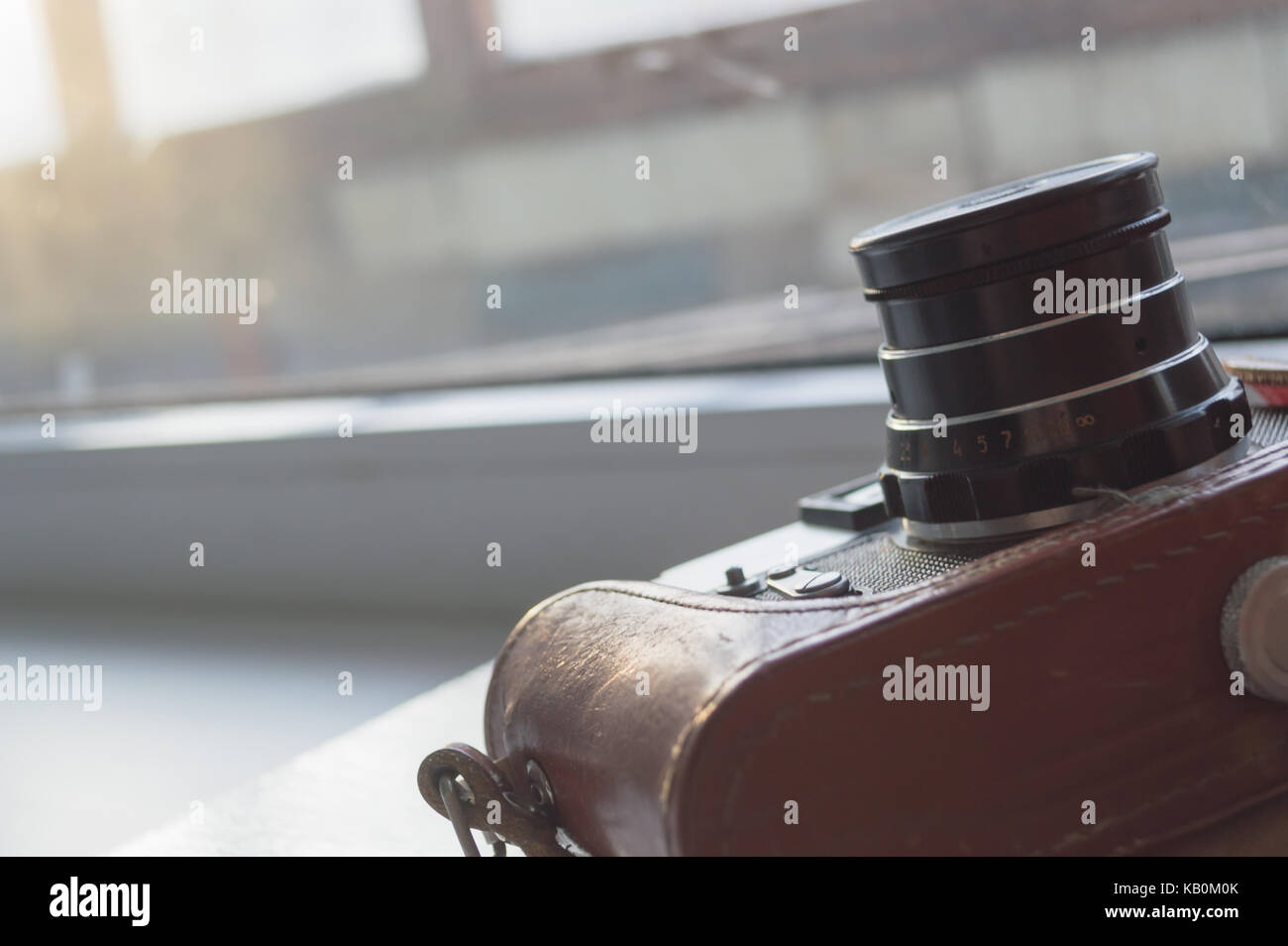 old camera in leather case - Stock Image