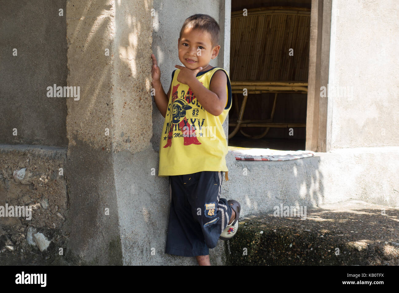 Philippines children - a young Filipino boy aged 5 years, El Nido, Palawan, Philippines, Asia - Stock Image