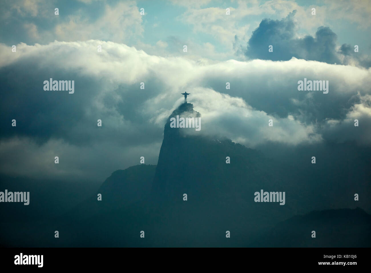 Christ the Redeemer in the clouds atop Corcovado, seen from Niteroi City Park, Niteroi, Rio de Janeiro, Brazil, Stock Photo