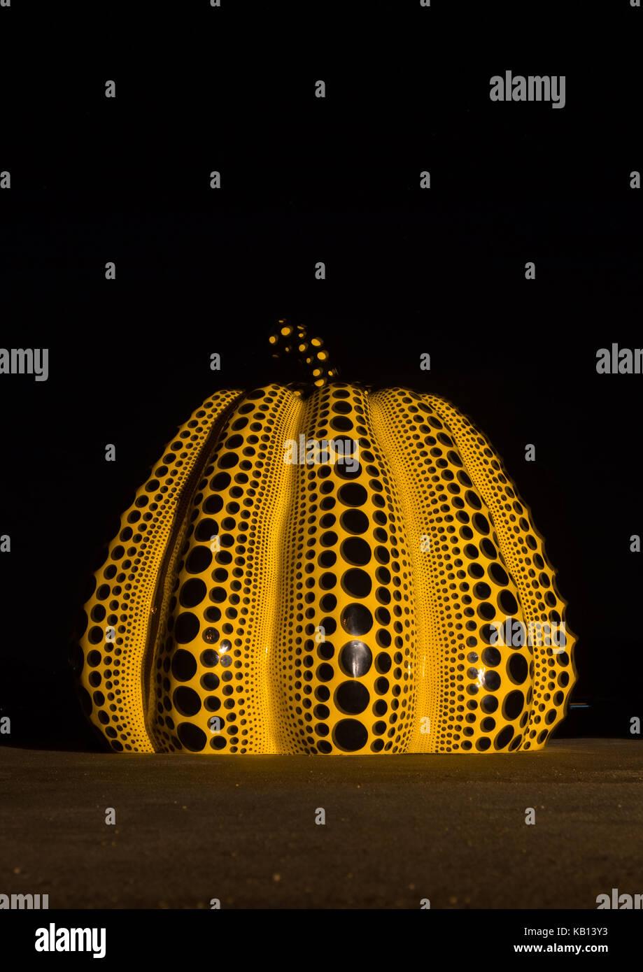 Yellow pumpkin by yayoi kusama on pier at night, Seto Inland Sea, Naoshima, Japan - Stock Image