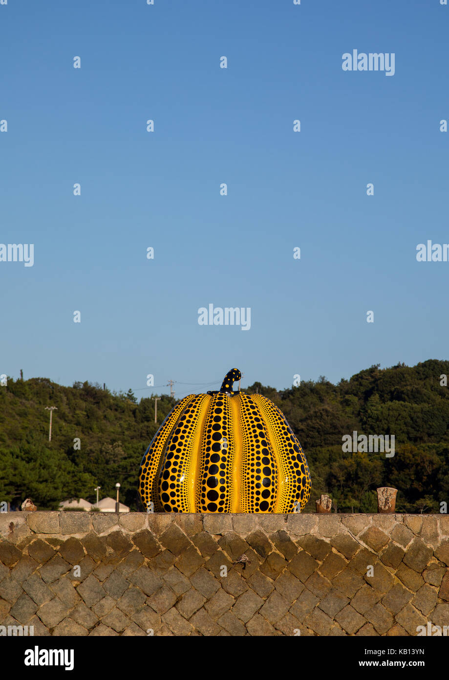 Yellow pumpkin by yayoi kusama on pier at sea, Seto Inland Sea, Naoshima, Japan Stock Photo