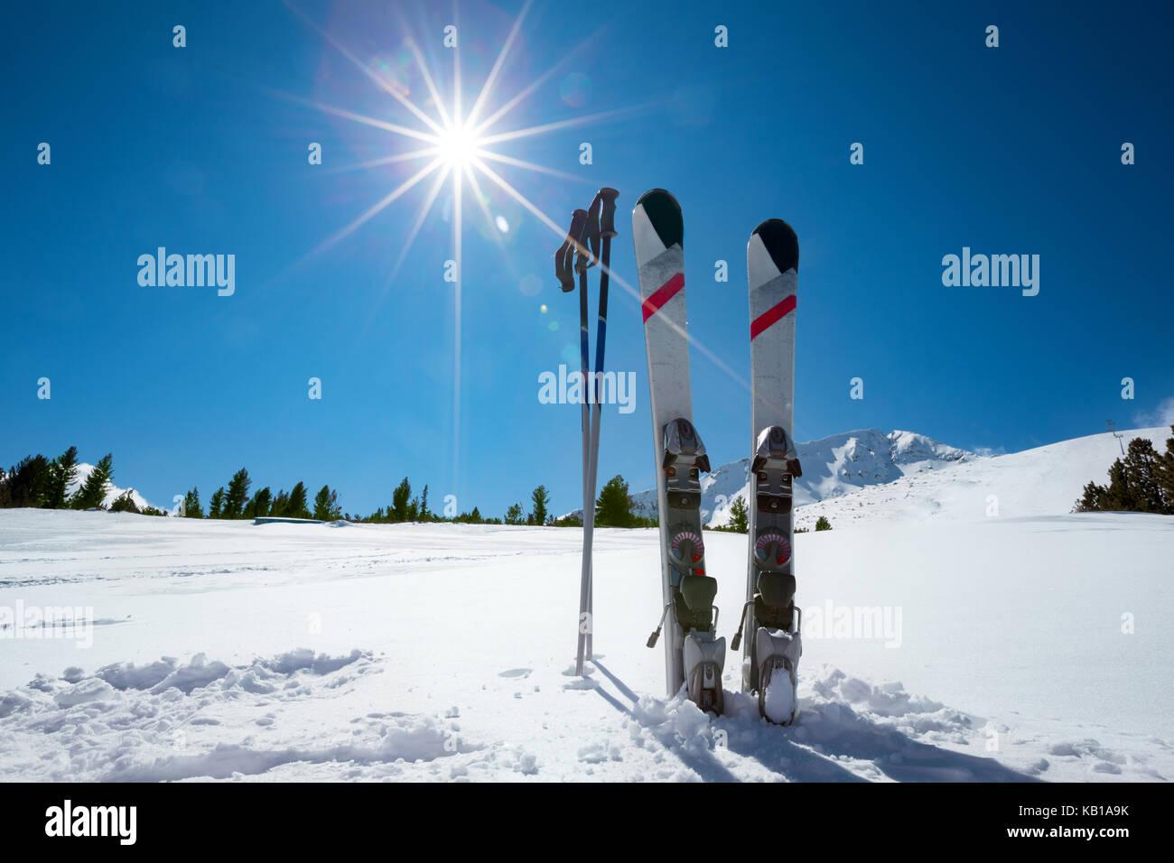 Skiing, winter season , mountains and ski equipment on ski run - Stock Image