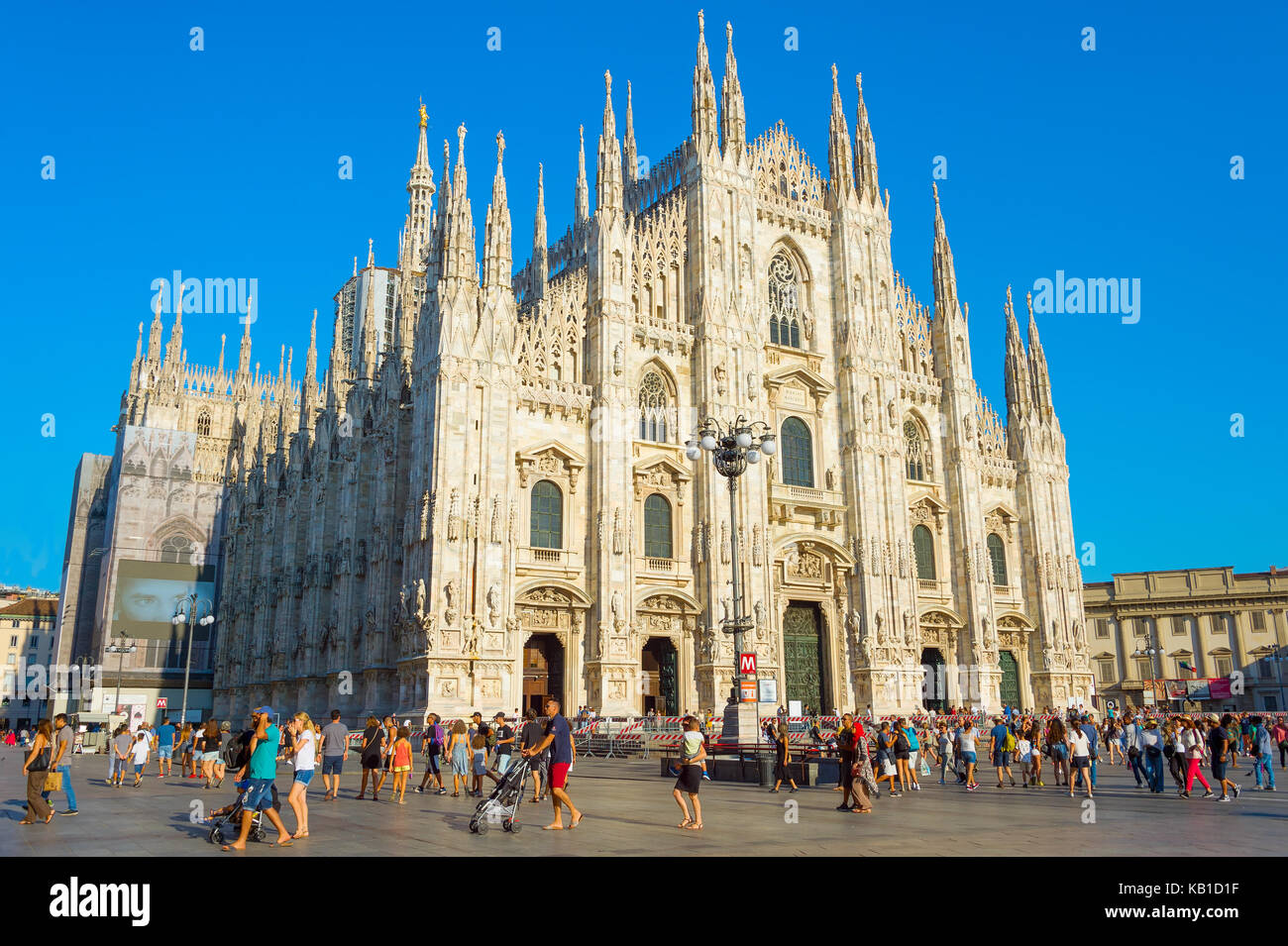 MILAN, ITALY - AUG 17, 2017: Tourists visiting Milan Cathedral (Duomo Milano). It is the largest church in Italy - Stock Image