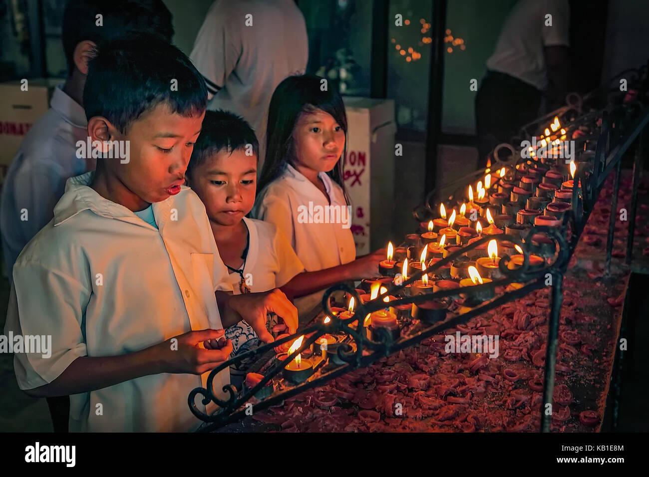 Filipino Catholic children light votive candles in the Santo Nino Parish Church in Tacloban City  sc 1 st  Alamy & Catholic Church Candle Lighting Stock Photos u0026 Catholic Church ...