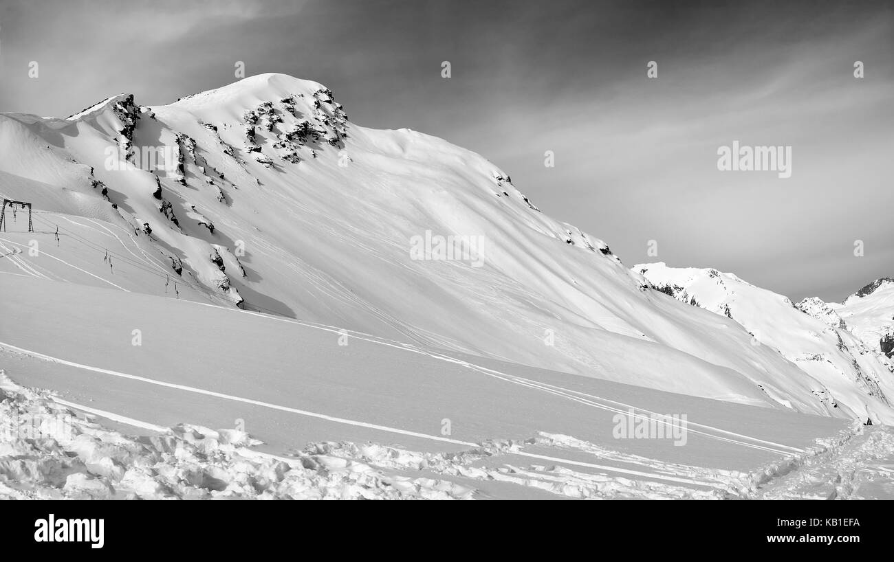 Black and white panoramic view on off-piste slope. Caucasus Mountains in winter, Elbrus region, mount Cheget. - Stock Image