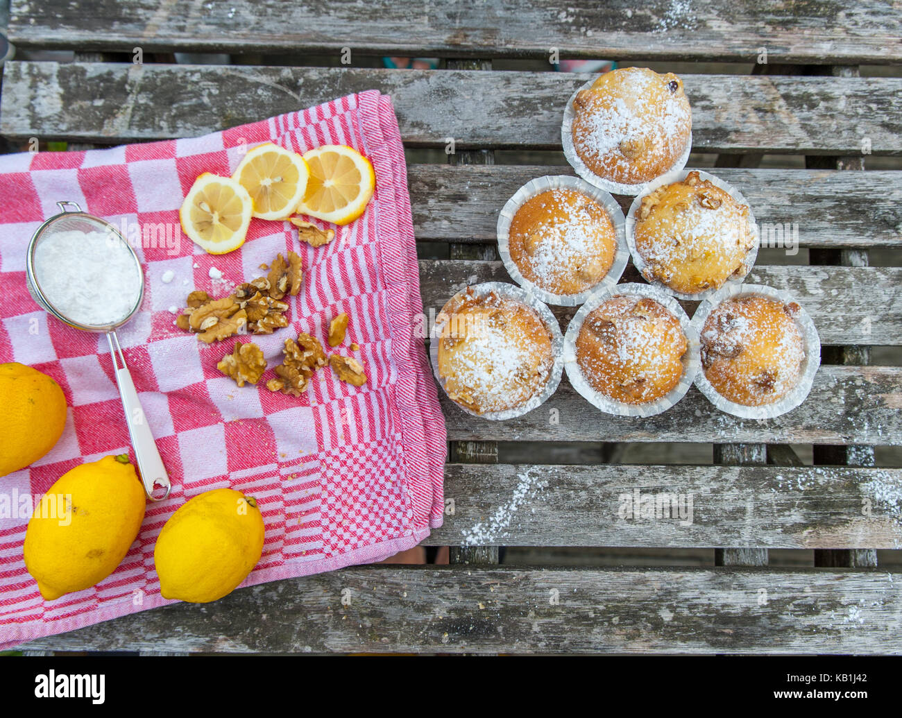 Homemade cupcakes with lemon on a wooden table - Stock Image