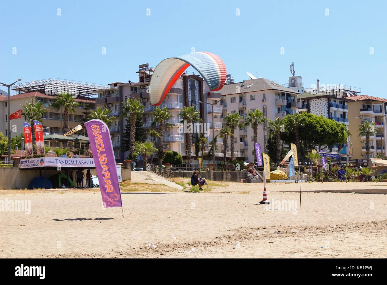 Paraglider landing in a special zone at Cleopatra Beach in Alanya (Turkey). Stock Photo