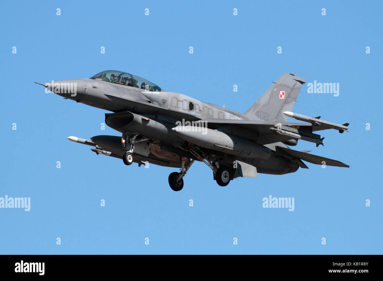 Modern military aviation. Polish Air Force F-16D combat jet aircraft on approach, equipped with conformal fuel tanks - Stock Image