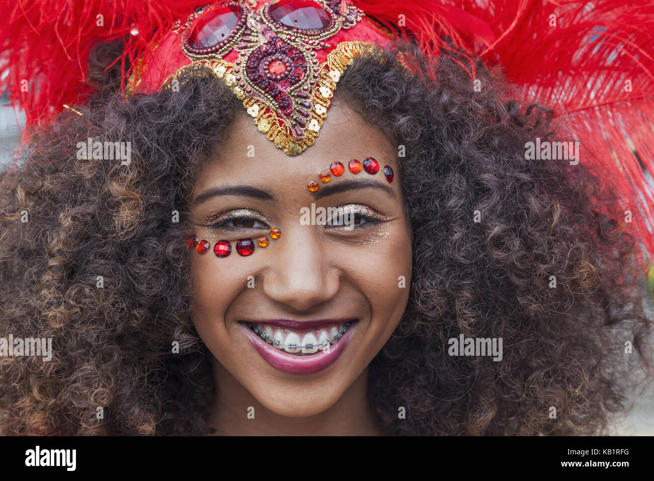 England, London, Notting Hill Carnival, woman, disguise, smile, portrait, - Stock Image