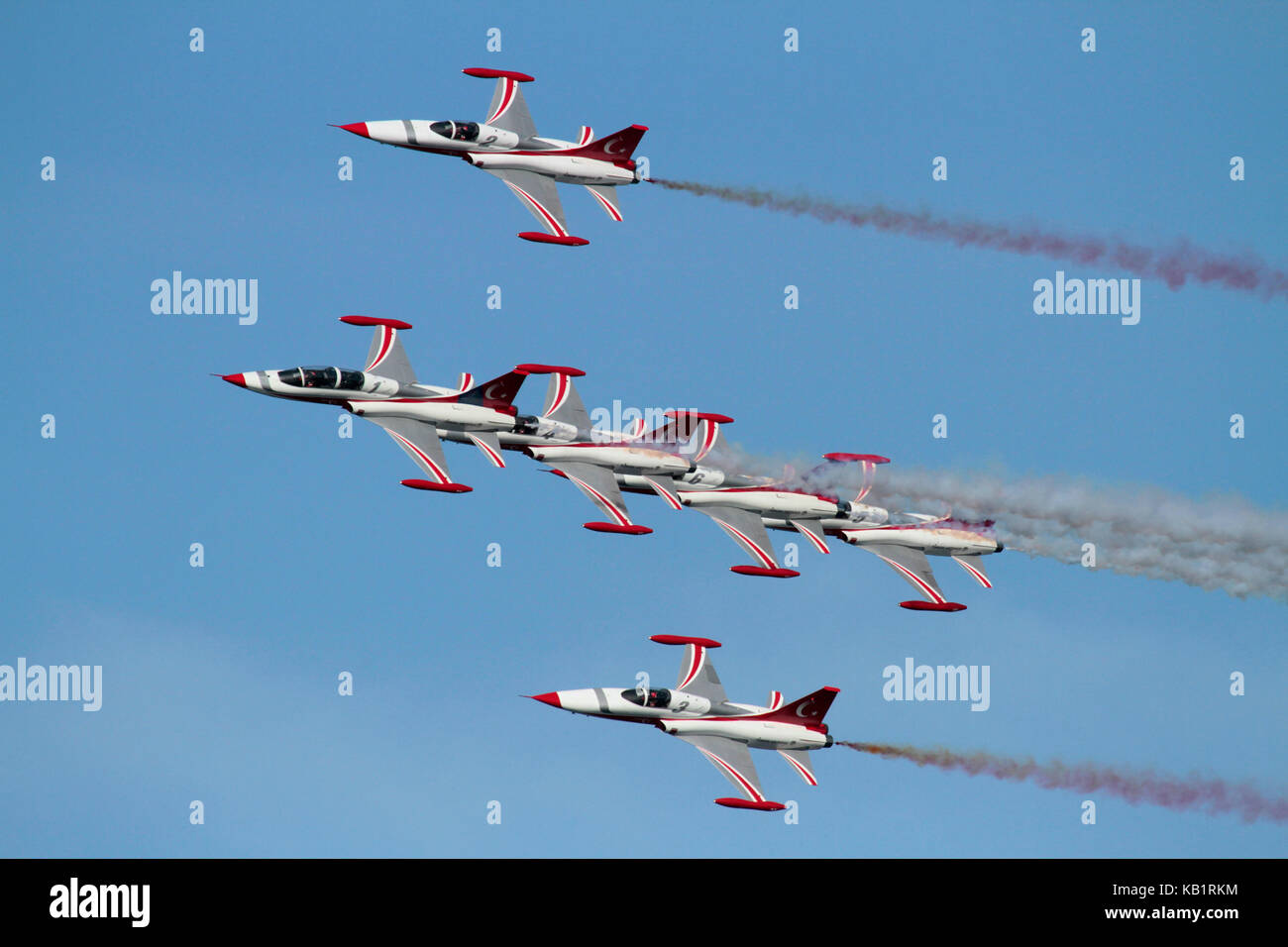 The Turkish Stars aerobatic display team flying their NF-5 combat jets in close formation - Stock Image