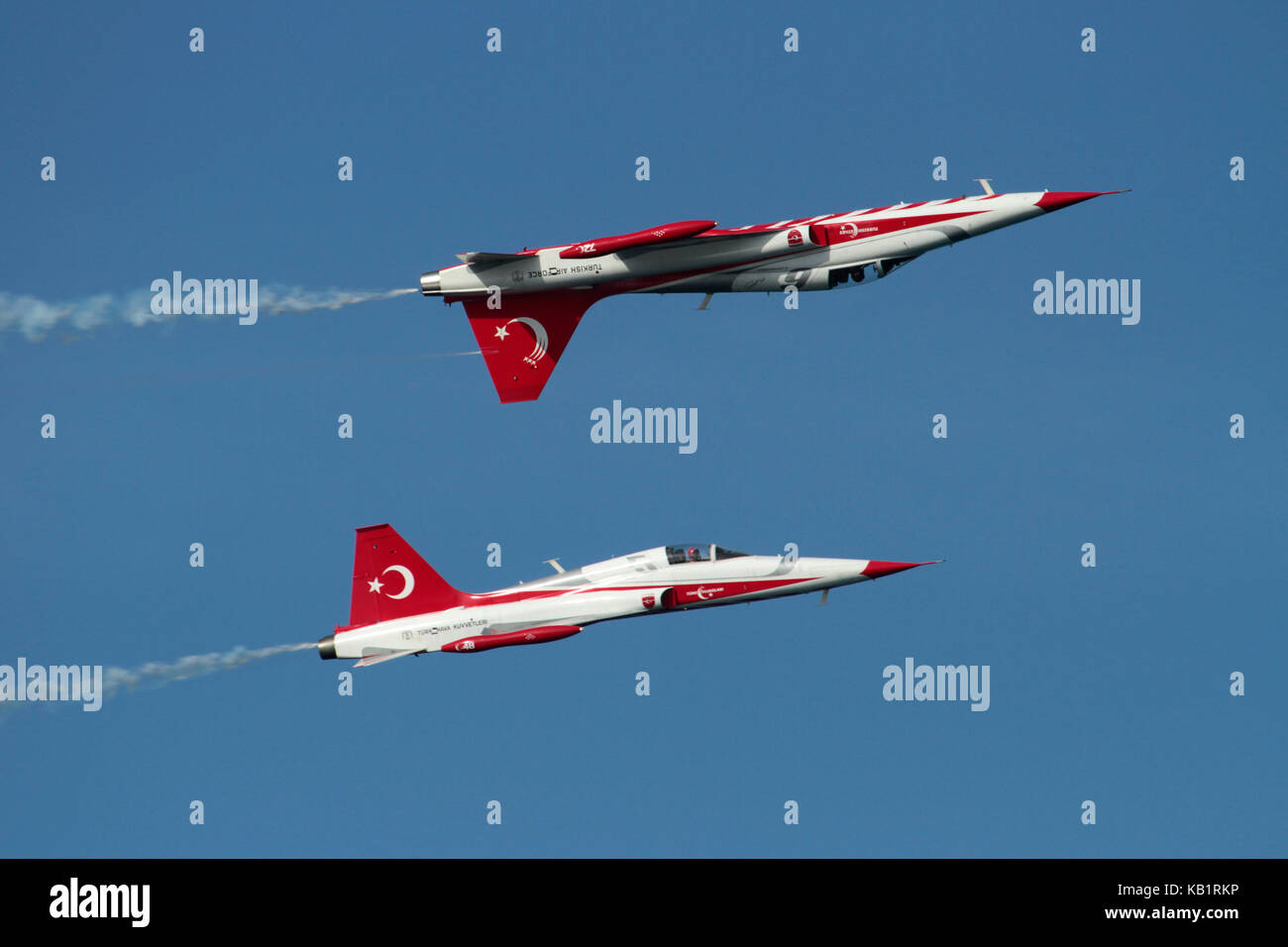 Two NF-5 jet fighters of the Turkish Stars display team (derivatives of the Northrop F-5A) during an airshow performance - Stock Image