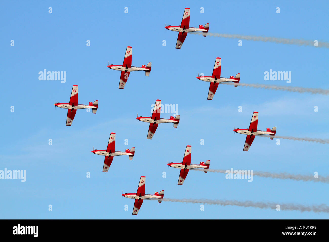 The Swiss Air Force PC-7 aerobatic display team flying in diamond formation during an airshow performance - Stock Image